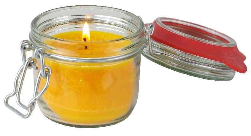 """Goldgelbe Kerze aus Stearin im Bügelglas mit der """"Blume des Lebens"""". Ohne Duft."""